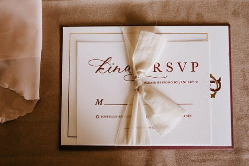 Invitation card with the inscription tied with ribbon