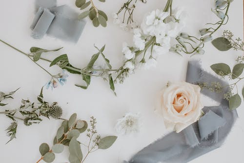 Flowers and branches with ribbon in floral workshop