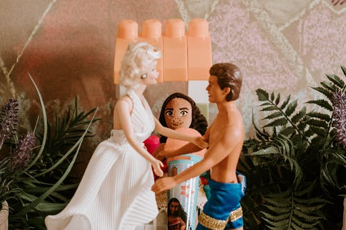 Toy couple of newlyweds at wedding day standing in front of each other before embrace