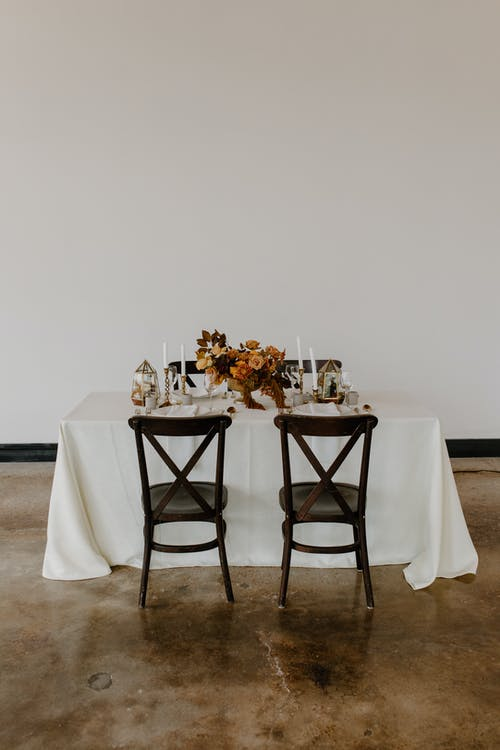 Served table decorated with candles and flowers