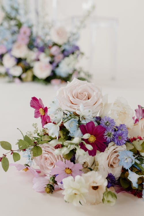Bouquet of fresh flowers placed on table