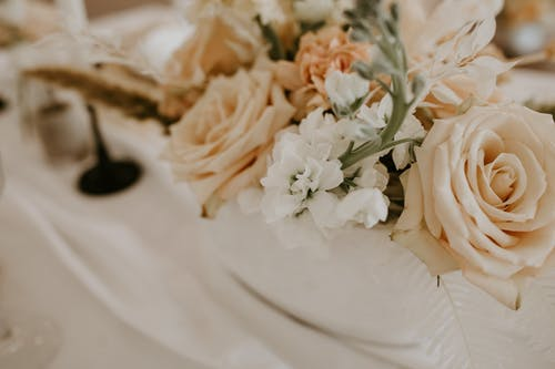 Bunch of delicate flowers on table on wedding day