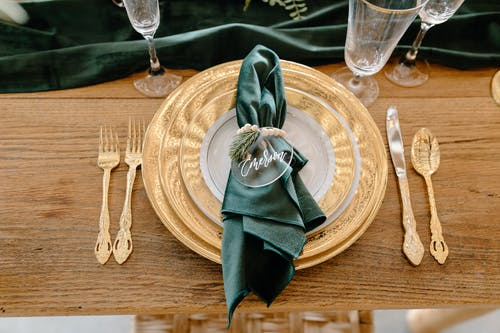 Table setting with elegant tableware and personalized napkin ring