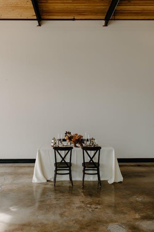 Served table with elegant floral composition during festive dinner