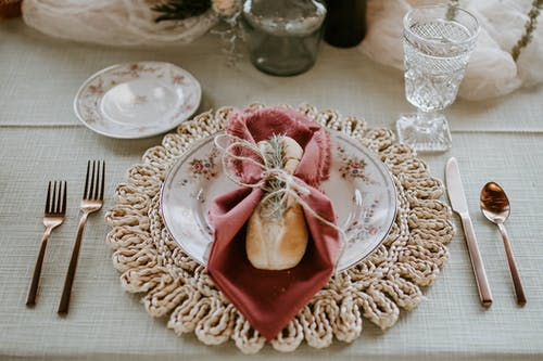 Elegant plate with bread and napkin served on decorated table