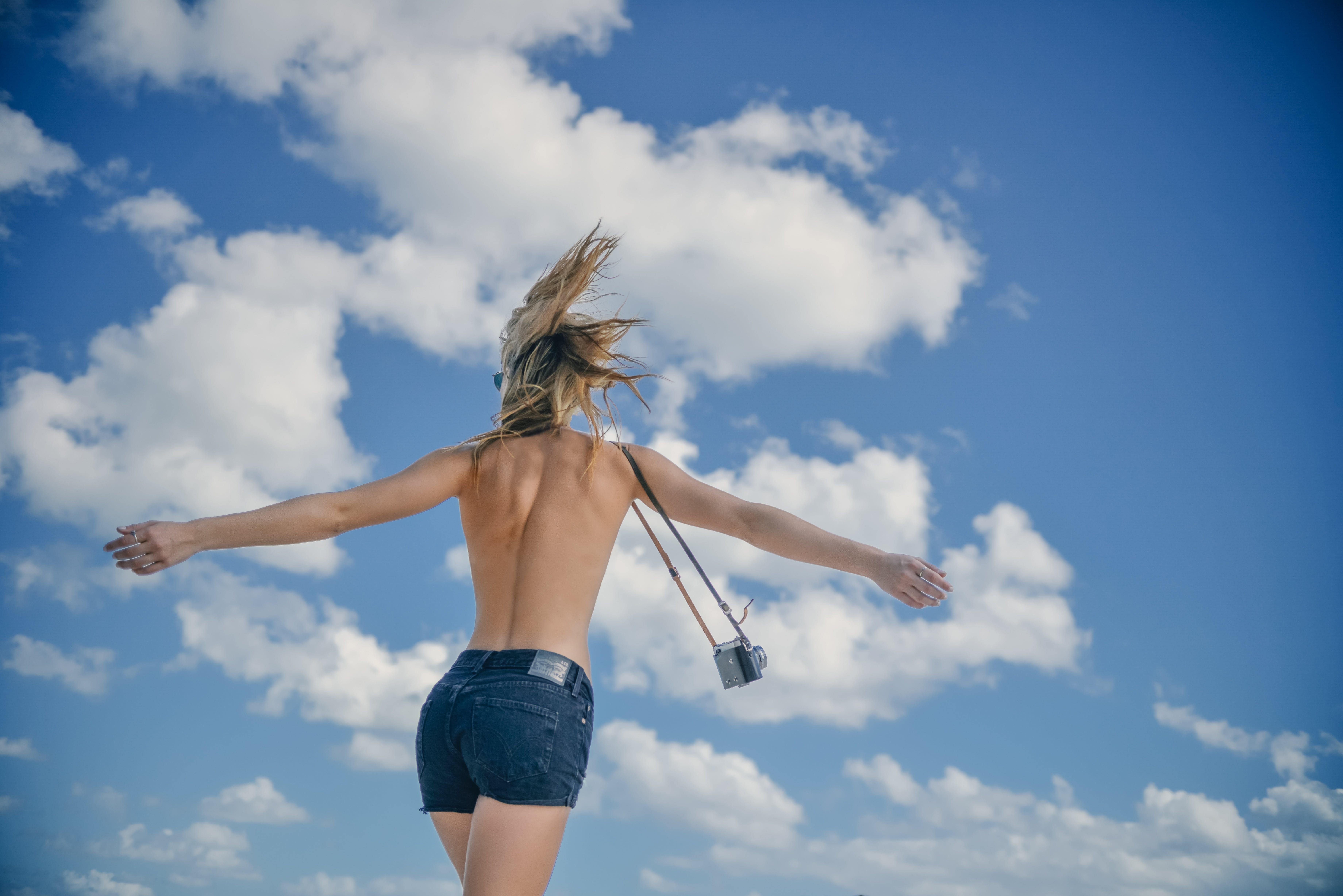 Topless Woman Wearing Blue Denim Short Shorts Doing Open Arms