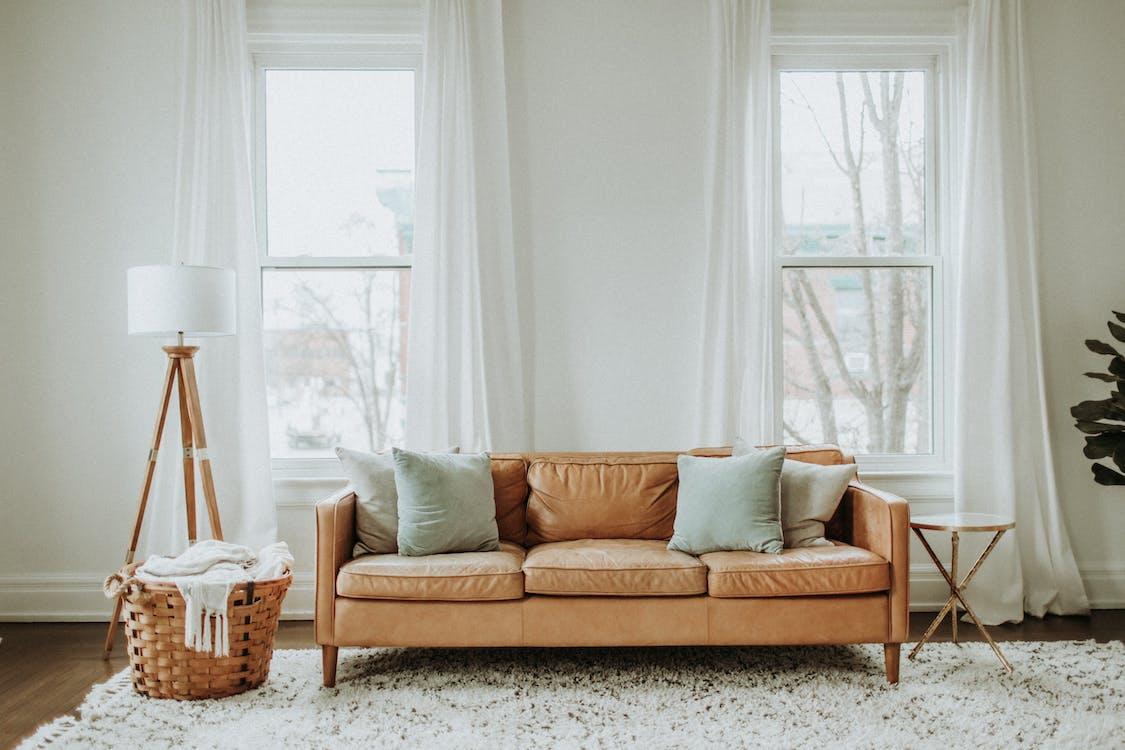 White and Brown Sofa Chair Near White Window Curtain