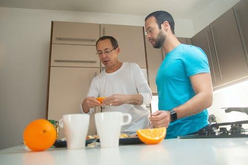 Бесплатное стоковое фото с апельсин, апельсиновые дольки, апельсиновый сок