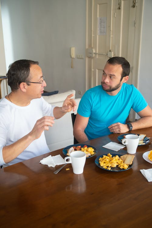 Men Having Breakfast