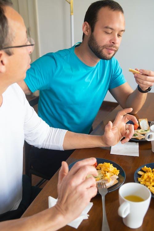 Men Eating Breakfast