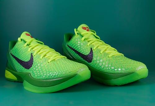 Green Nike Athletic Shoes on Green Surface