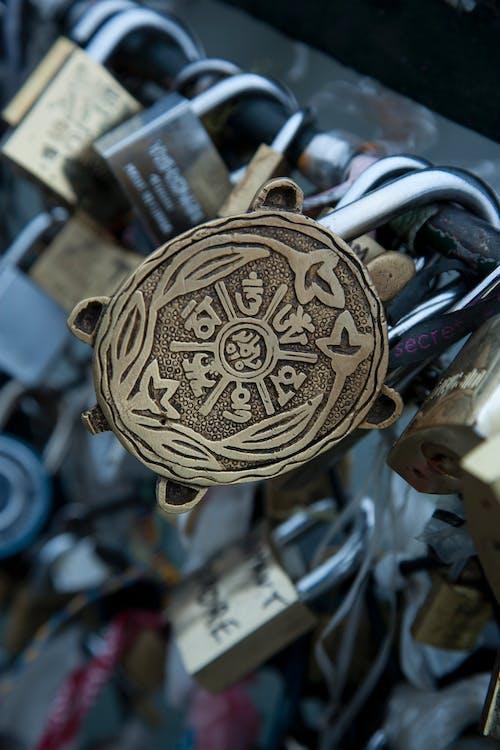 Tibetan antique brass lock attached on metal fence