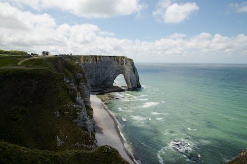 Rocky cliff on sandy coast