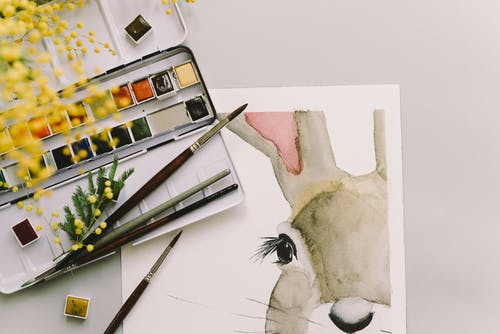 Photo Of Art Materials And Easter Bunny Painting