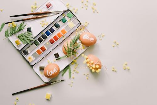 Color Palette Beside Painted Eggs