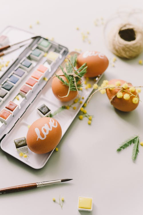 Brown Painted Eggs On A Watercolor Palette