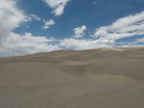 Free stock photo of desert clouds, sand dunes