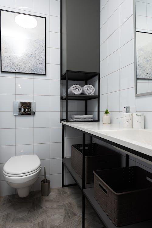 White Ceramic Sink Near White Ceramic Toilet Bowl