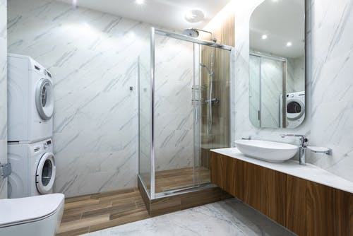 Interior of modern bathroom with shower cabin