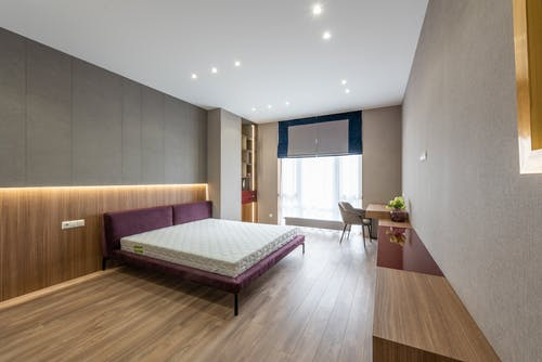 Spacious light bedroom with bed