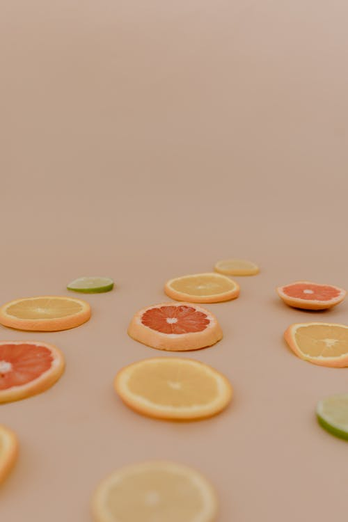Sliced Citrus Fruits on a Surface