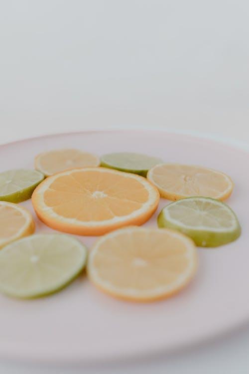 Sliced Citrus Fruits on Ceramic Plate