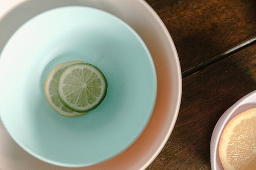 Bowls with sliced lemon and lime