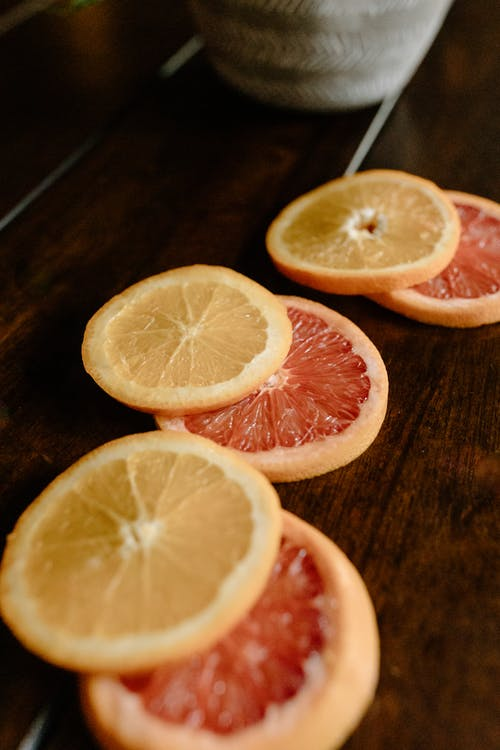 Sliced citrus fruits on wooden table