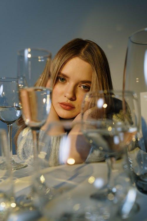 Woman Posing Behind Wine Glasses