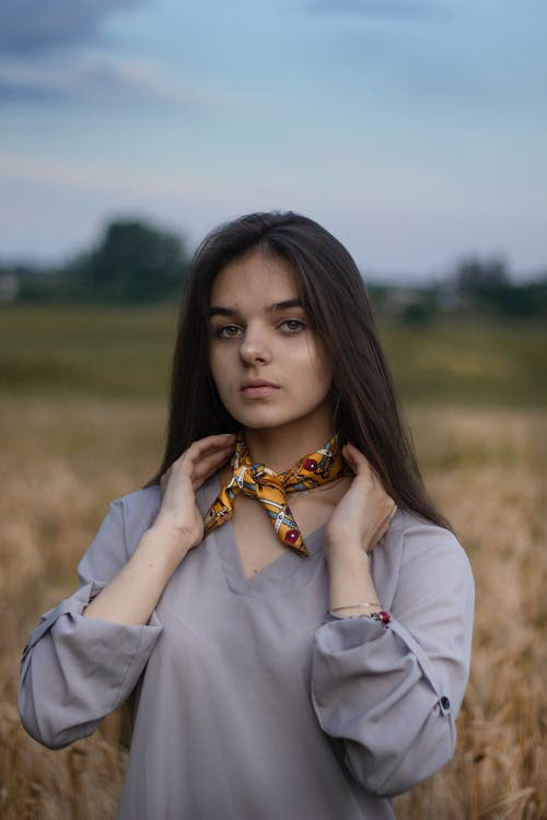 Woman Wearing a Scarf on Her Neck