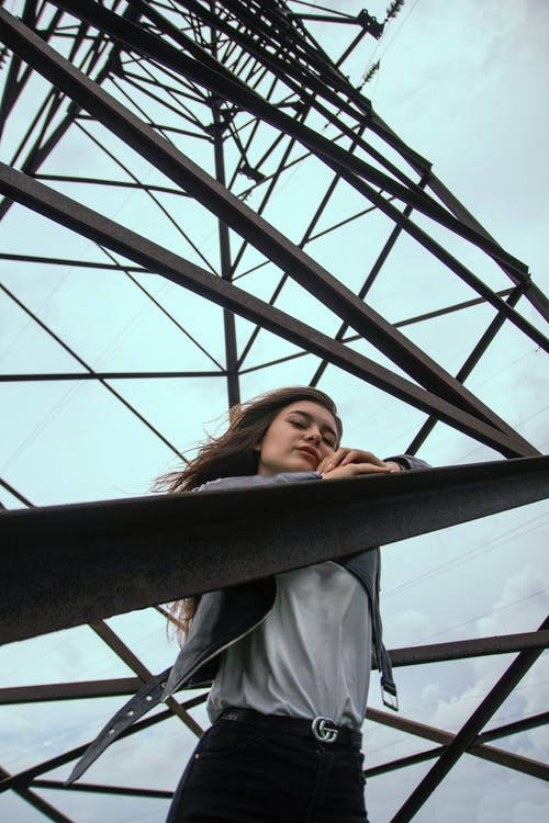 Woman Standing on the Transmission Tower
