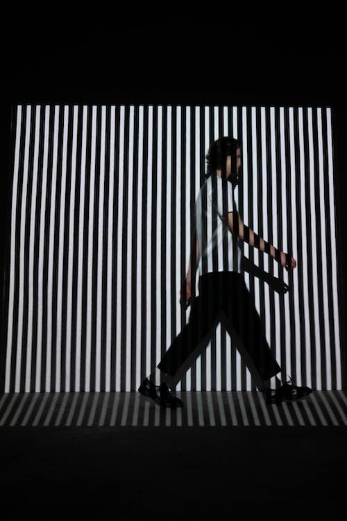 Man Walking on Stripe Wall