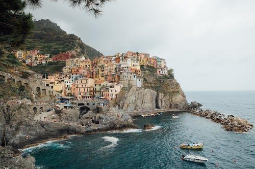 Rocky coast with houses near sea