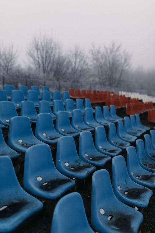 Blue Plastic Chairs on Field