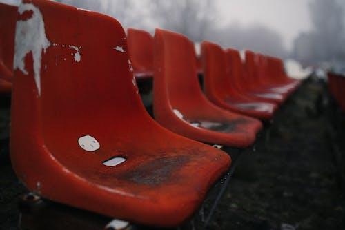 Red Plastic Chair on Black Concrete Floor