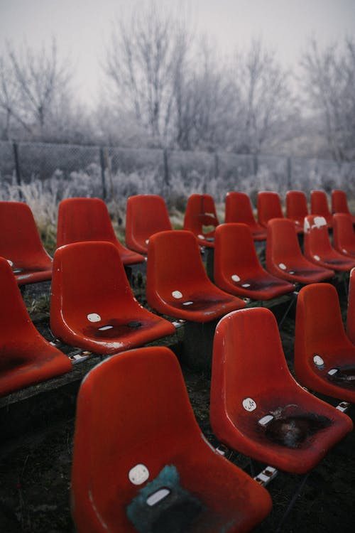 Red Chairs on Brown Wooden Table