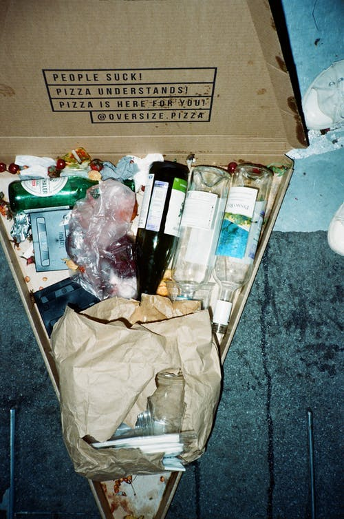 Bottles in Box on Gray Marble Table