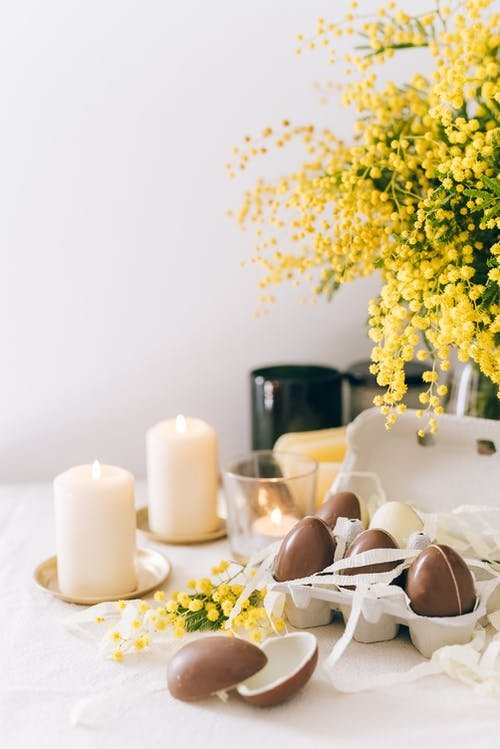 Brown Eggs And Lighted Candles On Table