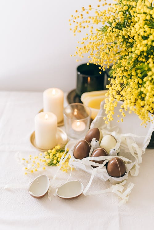 Flowers And Brown Eggs on White Table