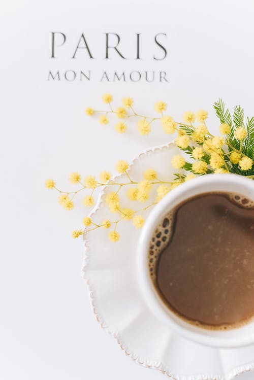 Cup Of Coffee On A Saucer With Flowers