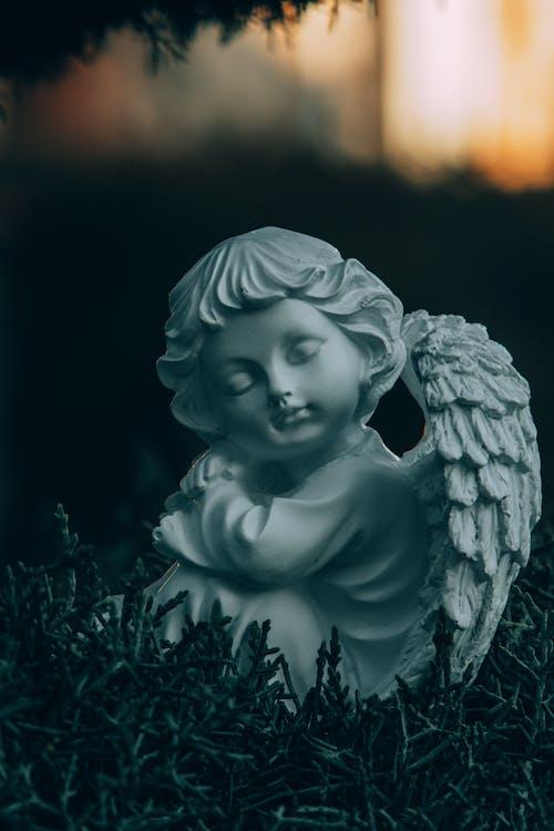 Angel Ceramic Figurine on Green Grass