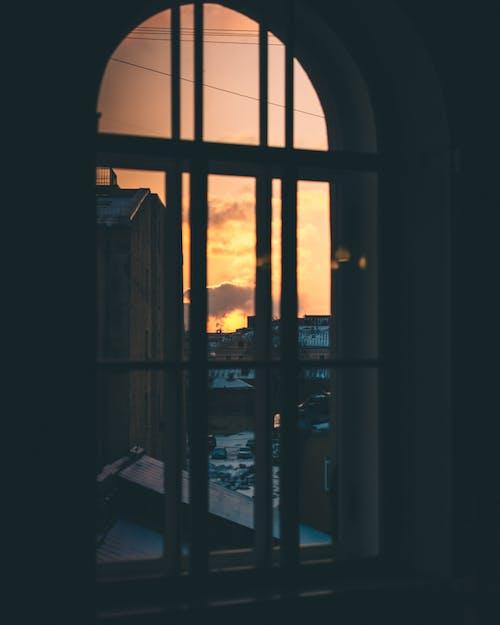 Through window of city at sunset