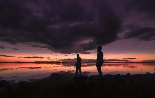 Two People Standing on Shore