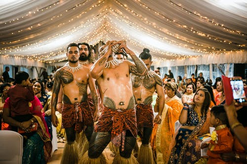 Samoan male dancers performing show during Indian wedding
