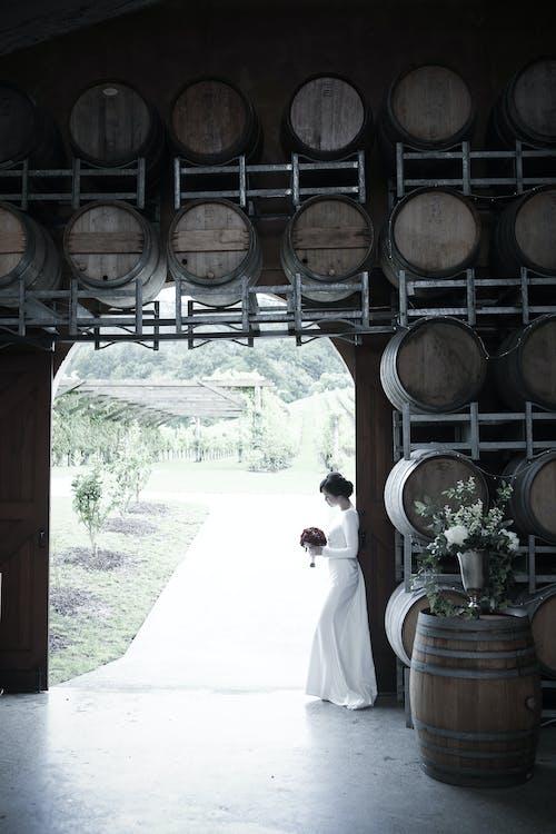 Elegant anonymous bride standing in winery