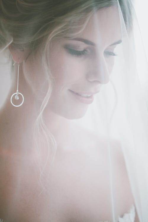 Bride in wedding dress and white veil