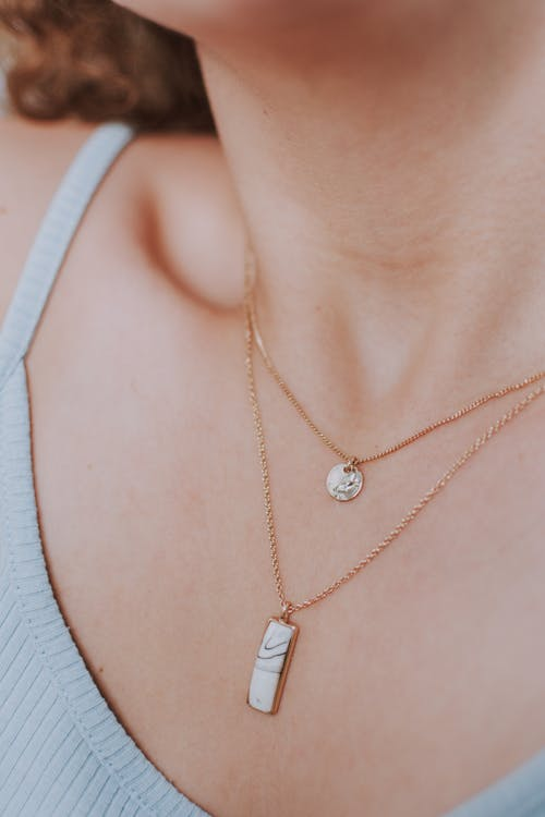 Anonymous woman with trendy feminine necklace