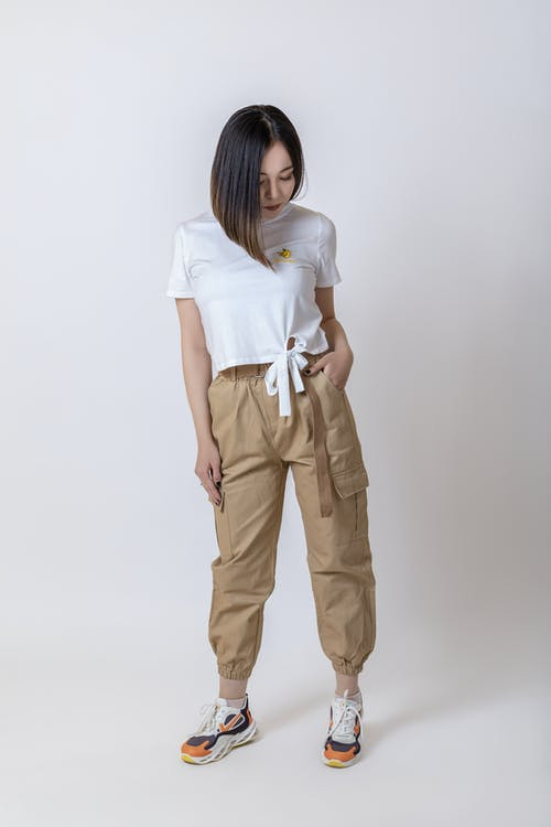 Woman in White Shirt and Brown Pants