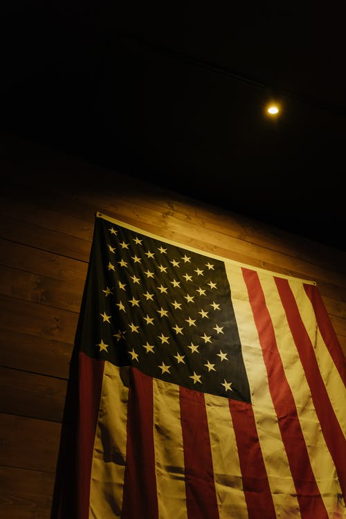 Us a Flag on Brown Wooden Wall