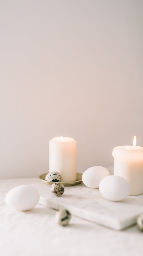 Eggs And Lighted Candle On Table